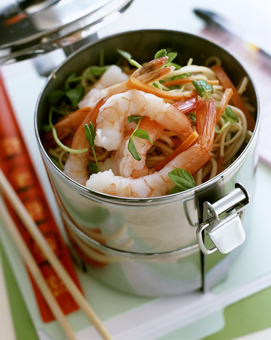 Asian pan-cooked noodles with shrimps in a food storage box