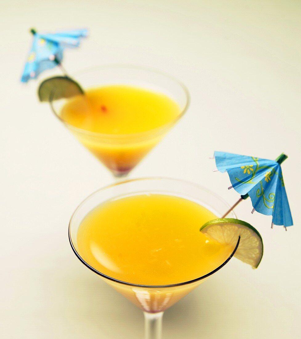 Mango Martinis with Lime and Umbrella Garnish