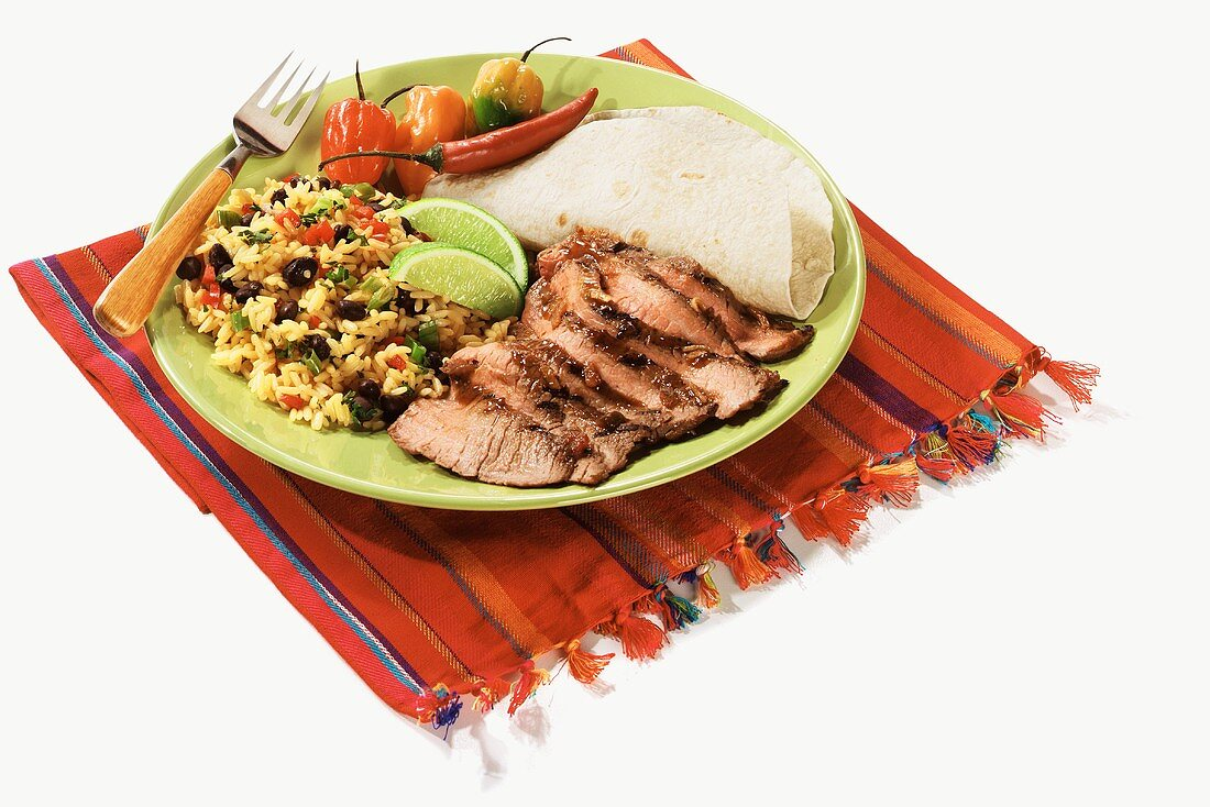 Carne Asada: Marinated Flank Steak with Tortillas and Rice and Beans