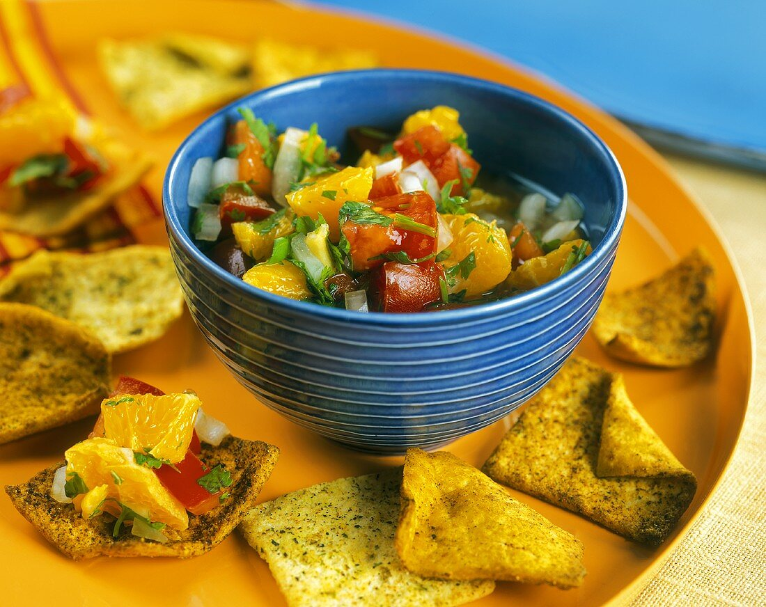 A Bowl of Clementine Salsa with Seasoned Crackers