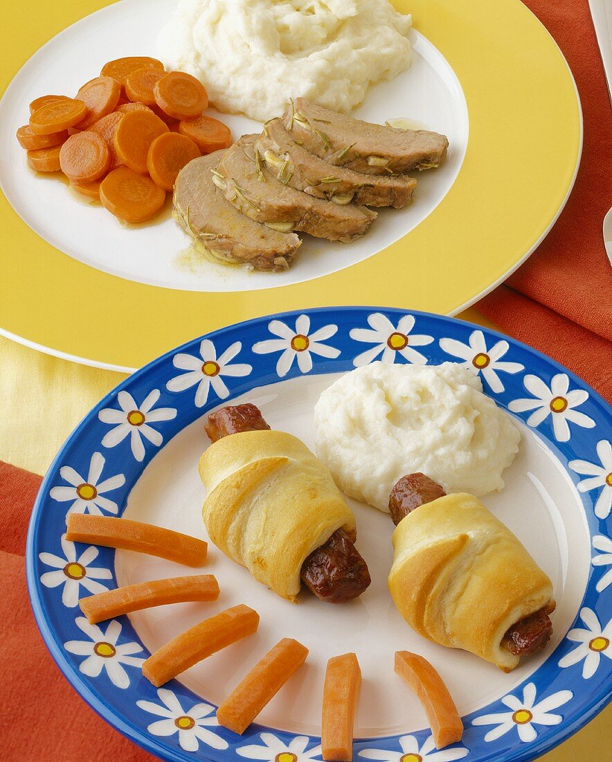 Pigs in a Blanket with Mashed Potato and Carrots (Kid's Meal) and Roast Pork with Mashed Potatoes and Carrots (Grown Up Meal)
