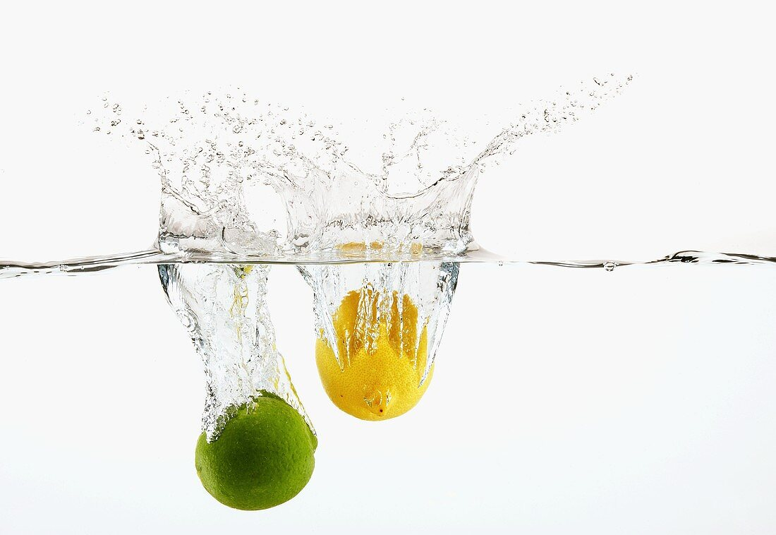 A Lime and a Lemon Splashing into Water