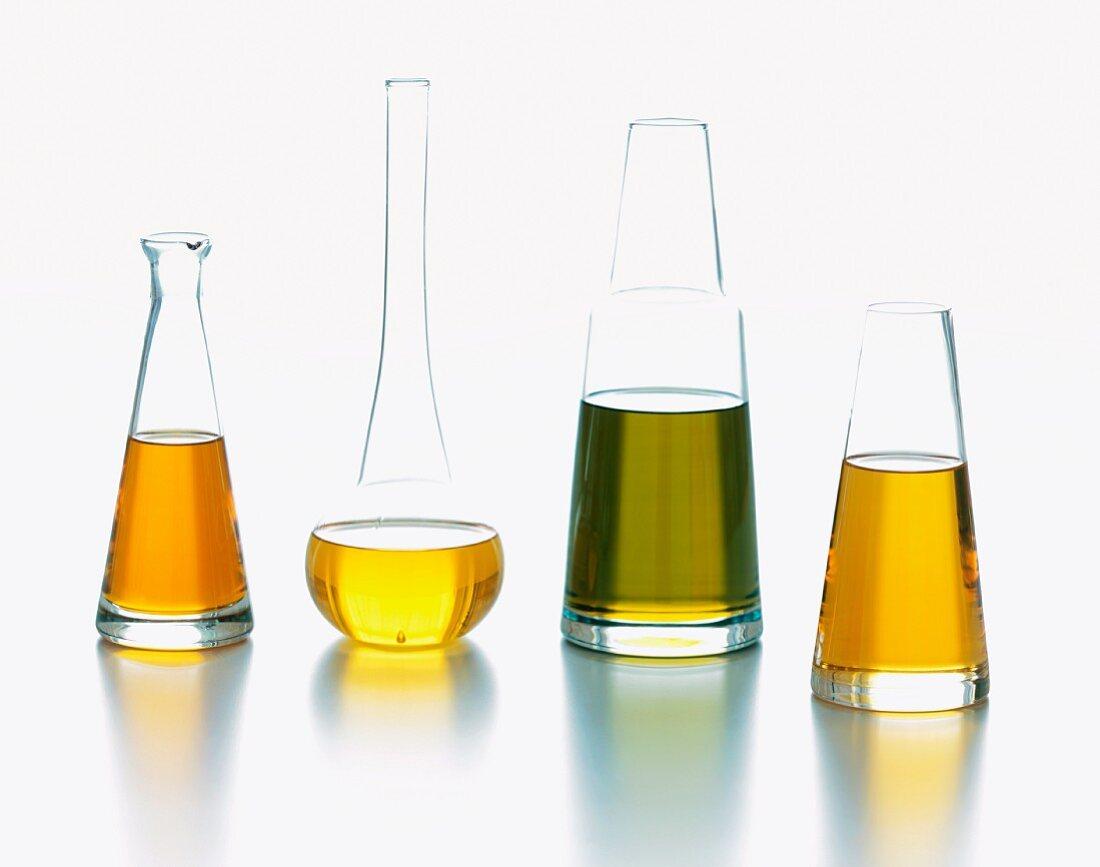 Four Glass Jars of Assorted Oils