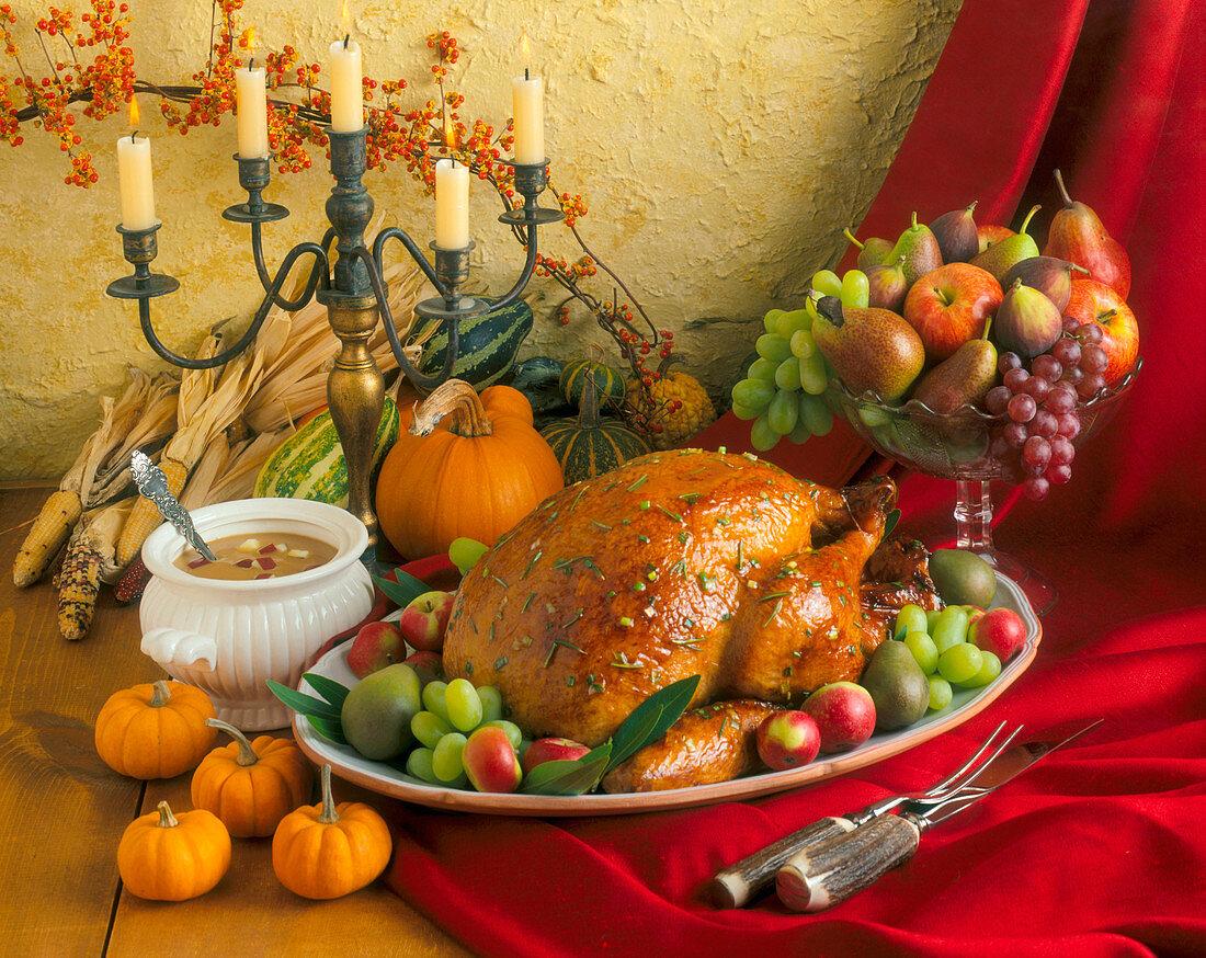 A Thanksgiving Roast Turkey with Gravy, Fresh Fruit and Pumpkins