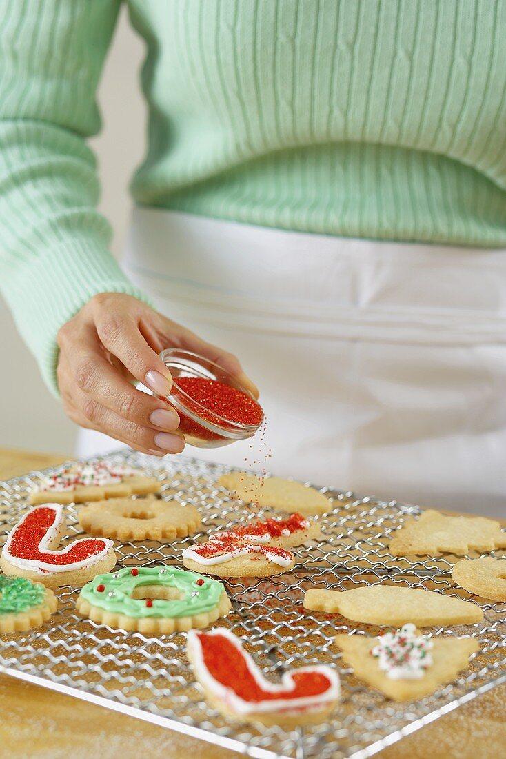 Putting Sprinkles on Holiday Cookies
