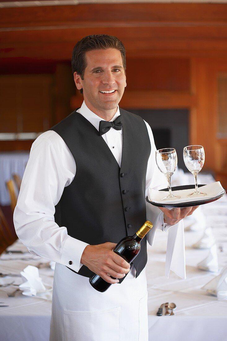 Waiter serving wine in a restaurant