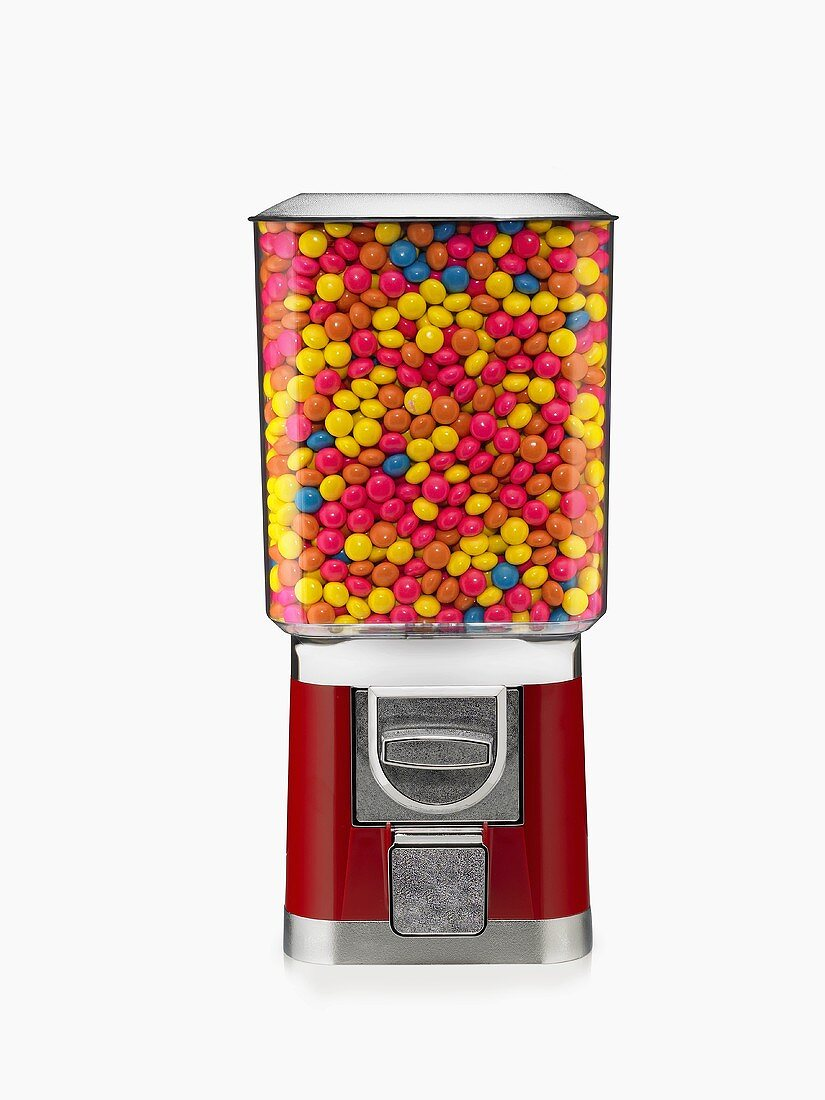 Candy Machine Full of Colorful Hard Candies on White Background