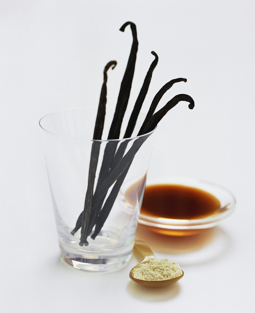 Vanilla pods, spoonful of vanilla powder and vanilla extract