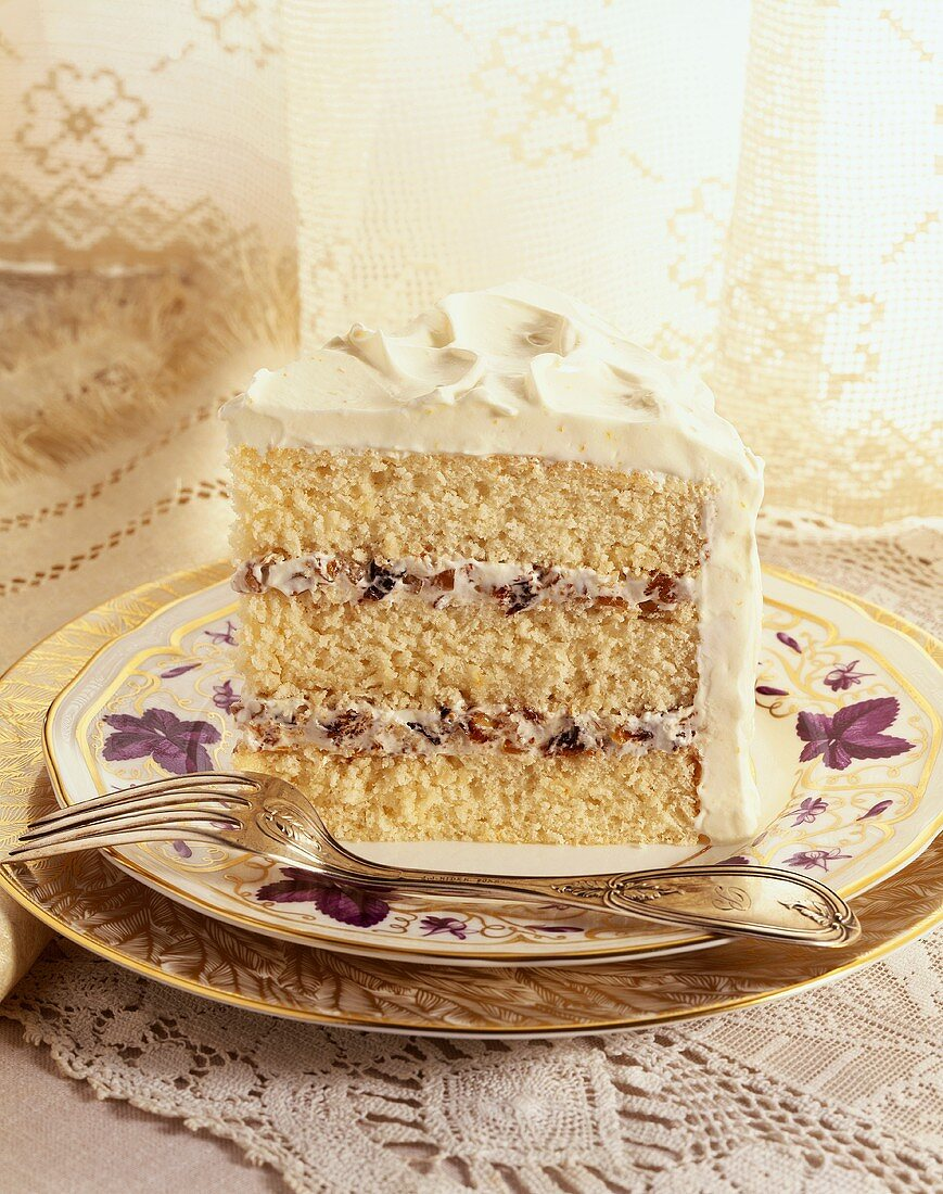 Single Slice of Lady Baltimore Cake on China with Fork