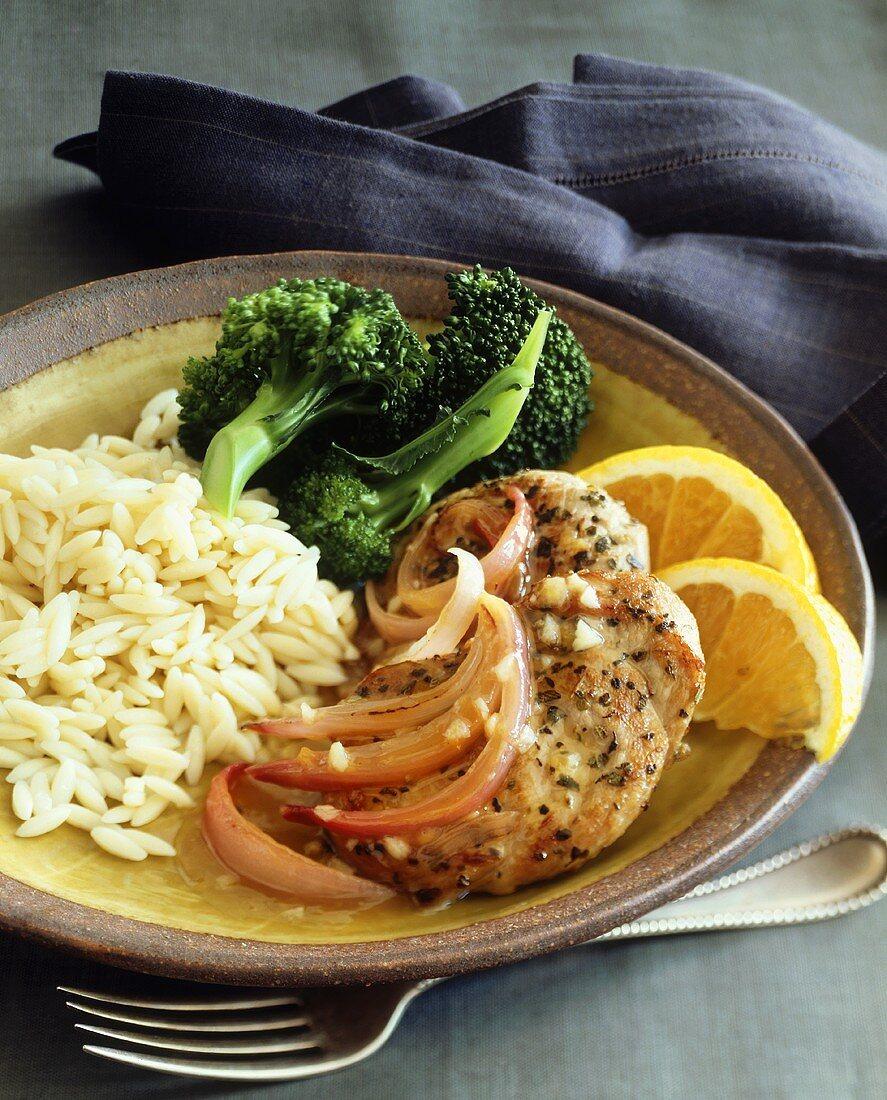 Turkey escalopes with orange sauce, rice and broccoli