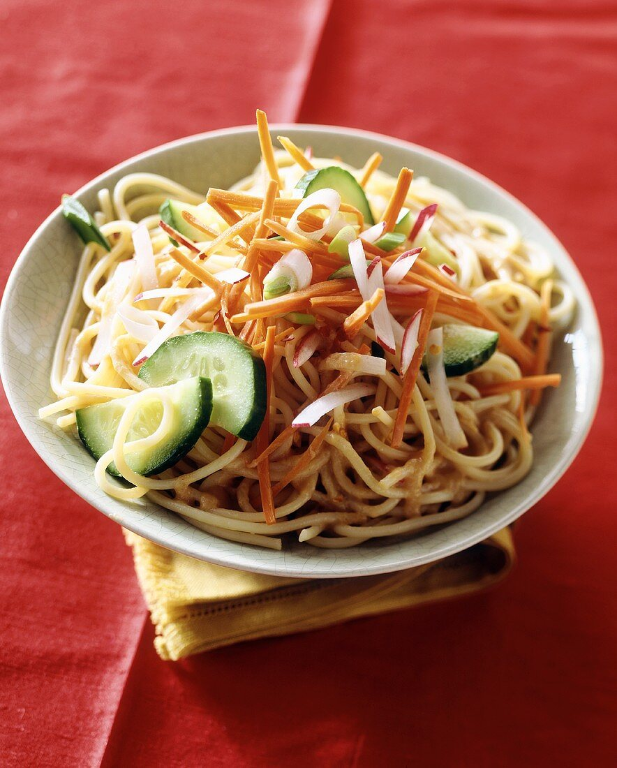 Pasta salad with vegetables and peanut sauce