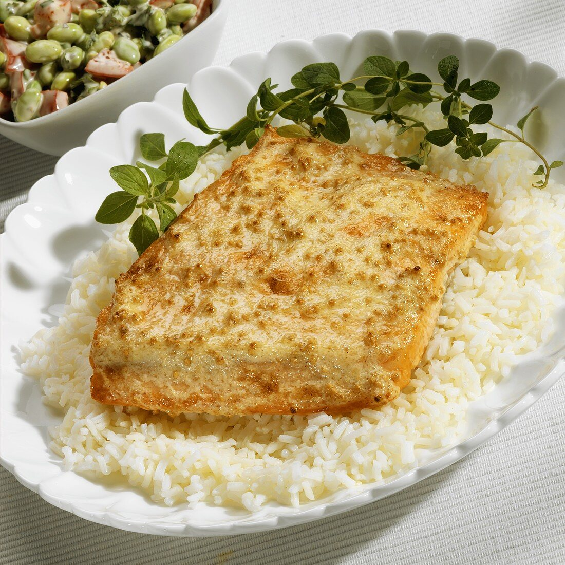 Salmon with mustard crust and oregano on bed of rice