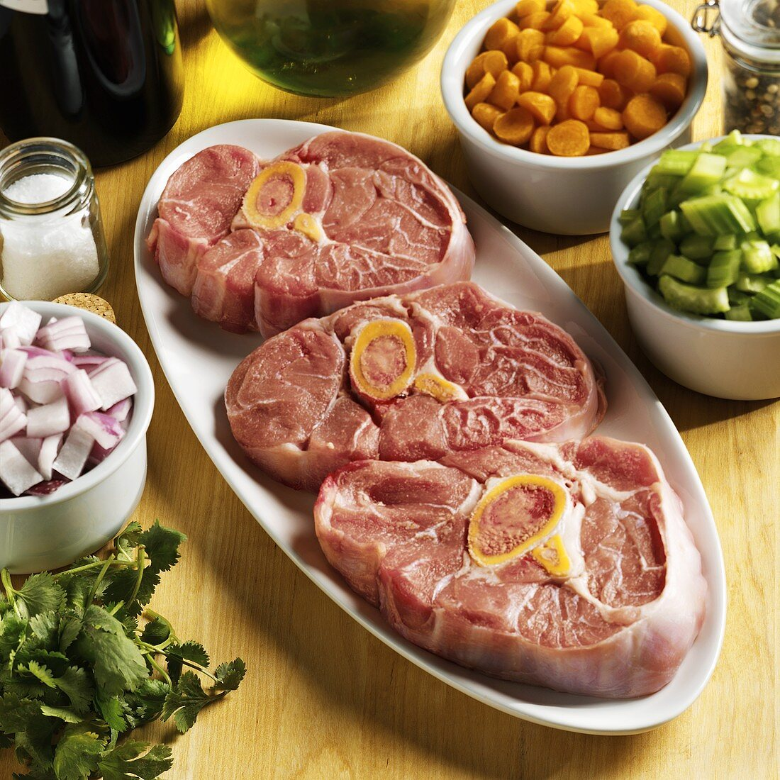 Ingredients for osso buco (veal shank slices & vegetables)