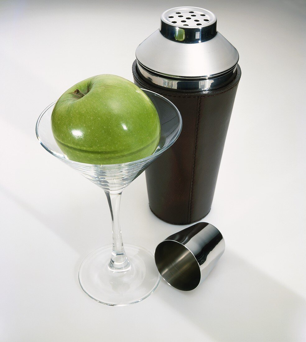 A Granny Smith Apple in a Martini Glass with Shaker