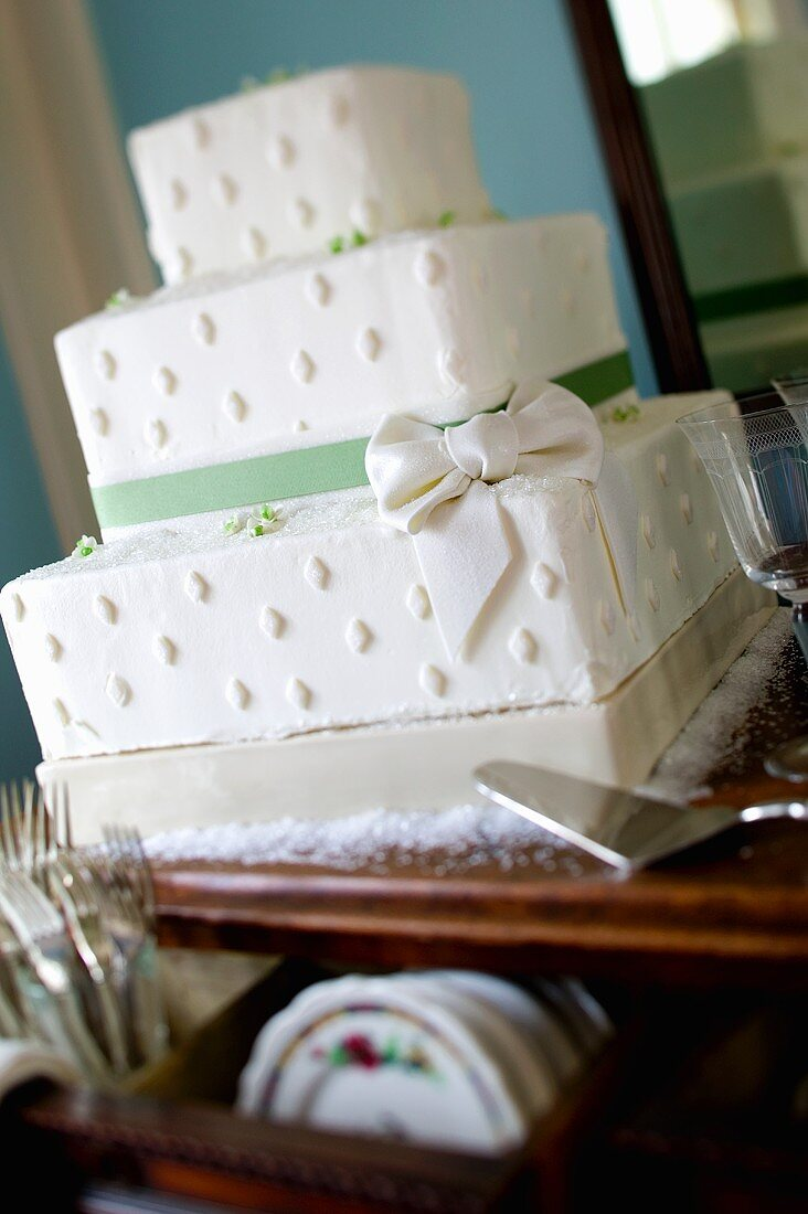 Three Tier Square Wedding Cake with Green Ribbon