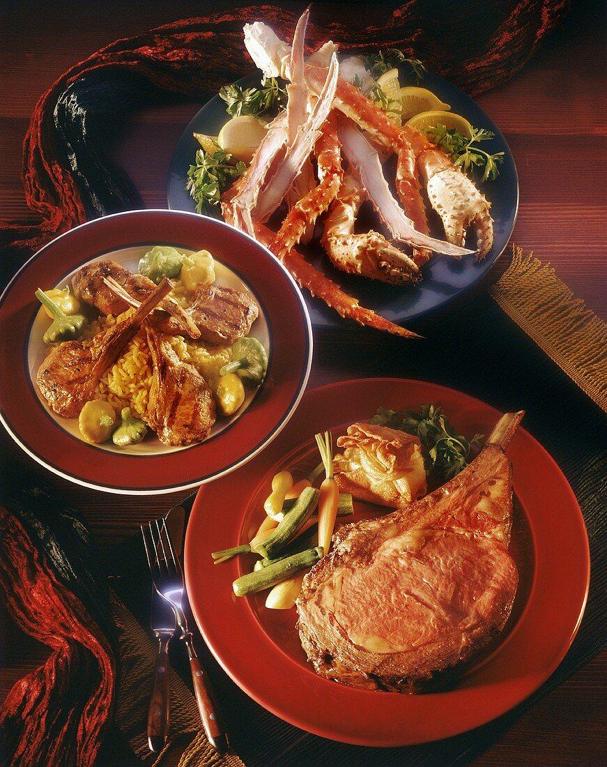 Three Dinner Plates of Prime Rib, Lamb Chops, and Crab Legs