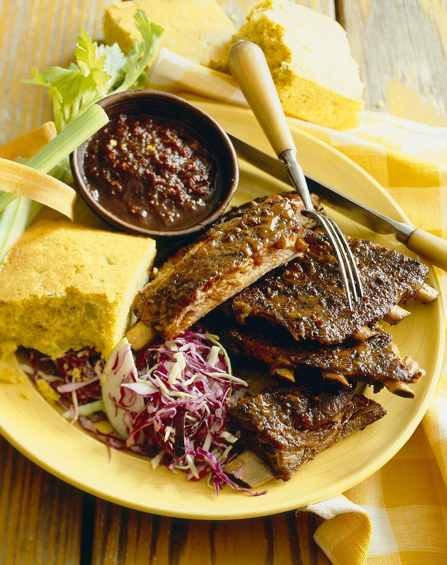 Plate of Barbeque Ribs with Cole Slaw and Corn Bread, Fork and Knife