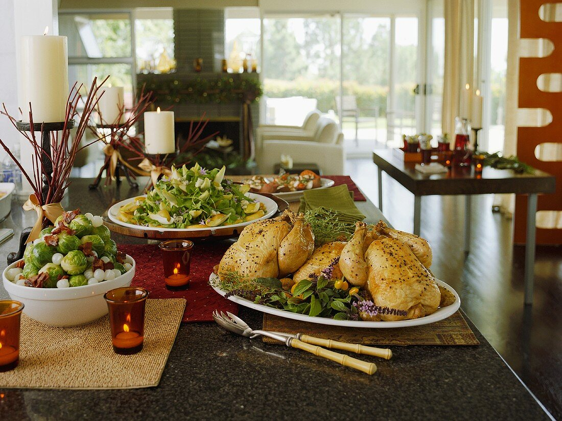 Table Set with Roast Chicken, Brussels Sprouts and Endive Salad; Candles