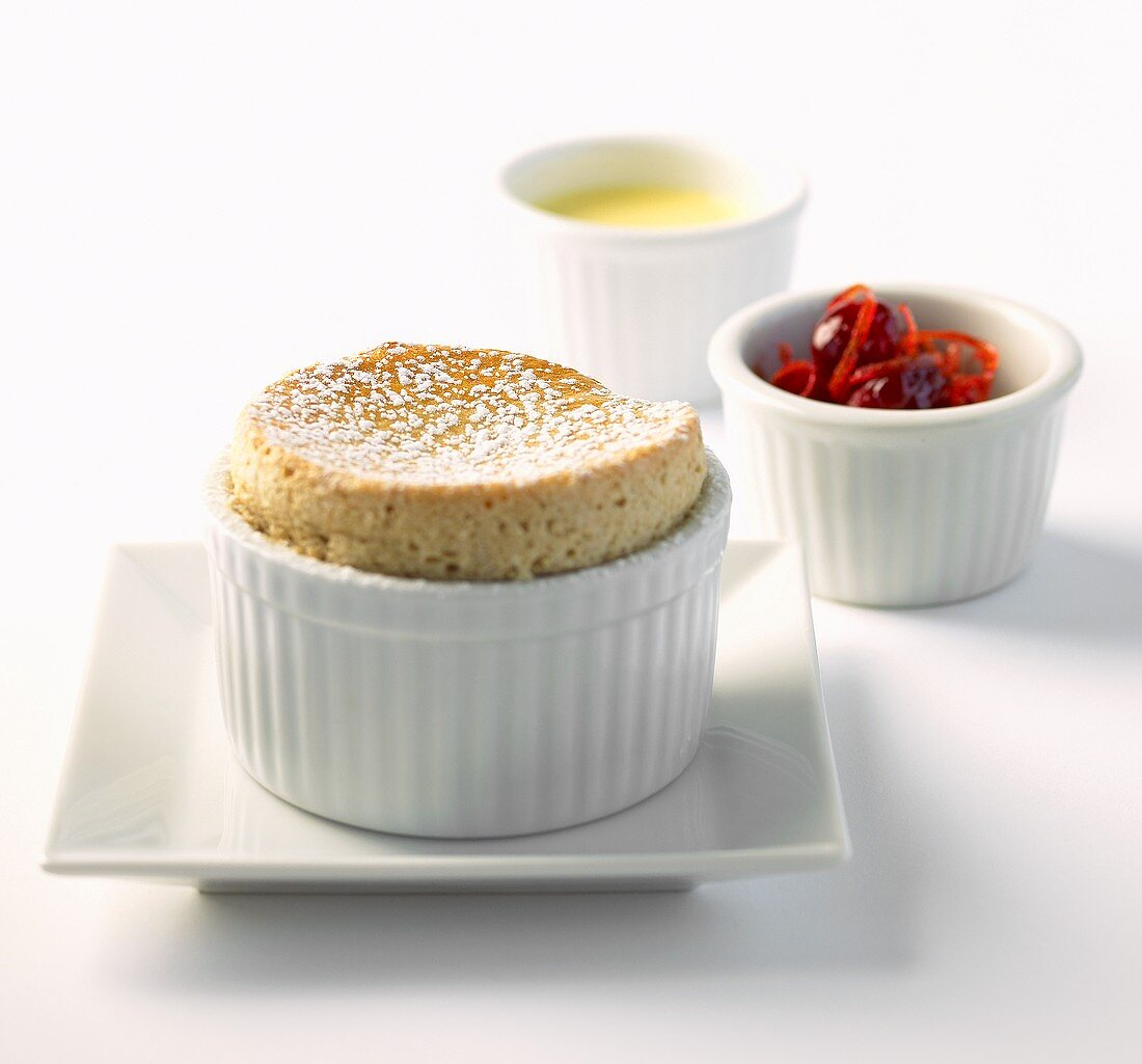 Souffle with Creme Anglais in Ramekin; Candied Citrus and Cherries