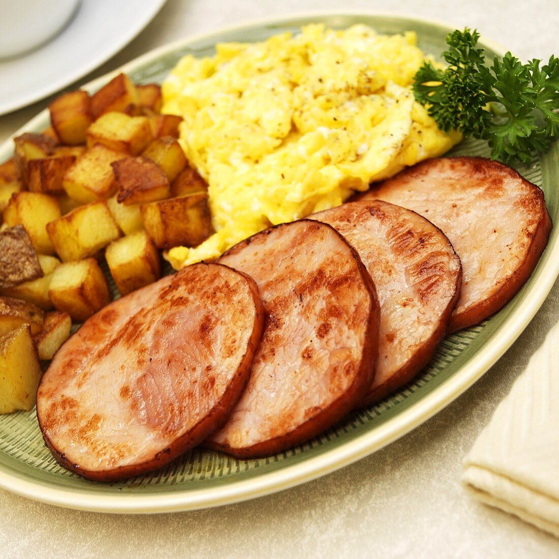 Breakfast Plate; Fried Canadian Bacon, Eggs and Home Fries