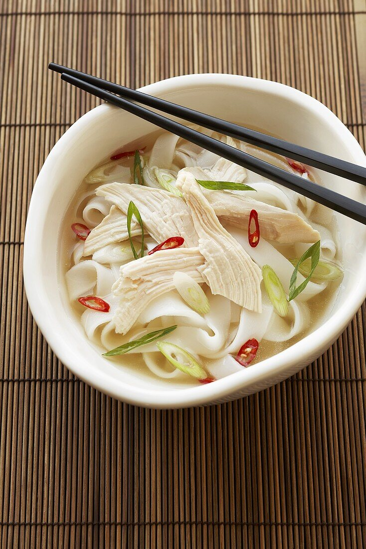 Bowl of Vietnamese Pho Chicken Soup; Chopsticks