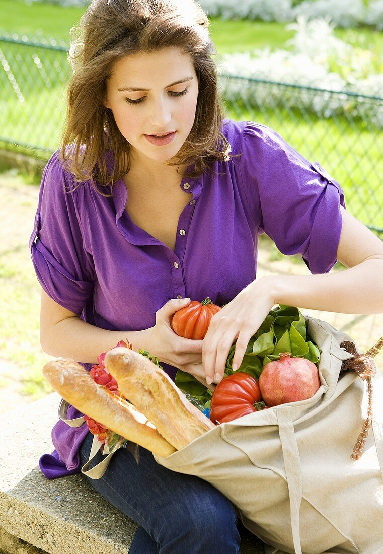 Woman Sorting Through Cloth Grocery Bag; Produce; Paris France