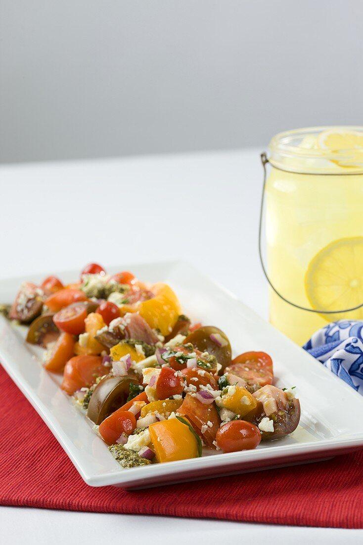 Heirloom Tomato and Feta Cheese Salad with Pesto Sauce; Lemonade