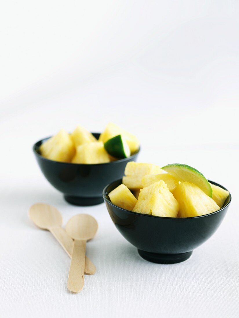 Two Bowls of Fresh Pineapple Chunks with Lime