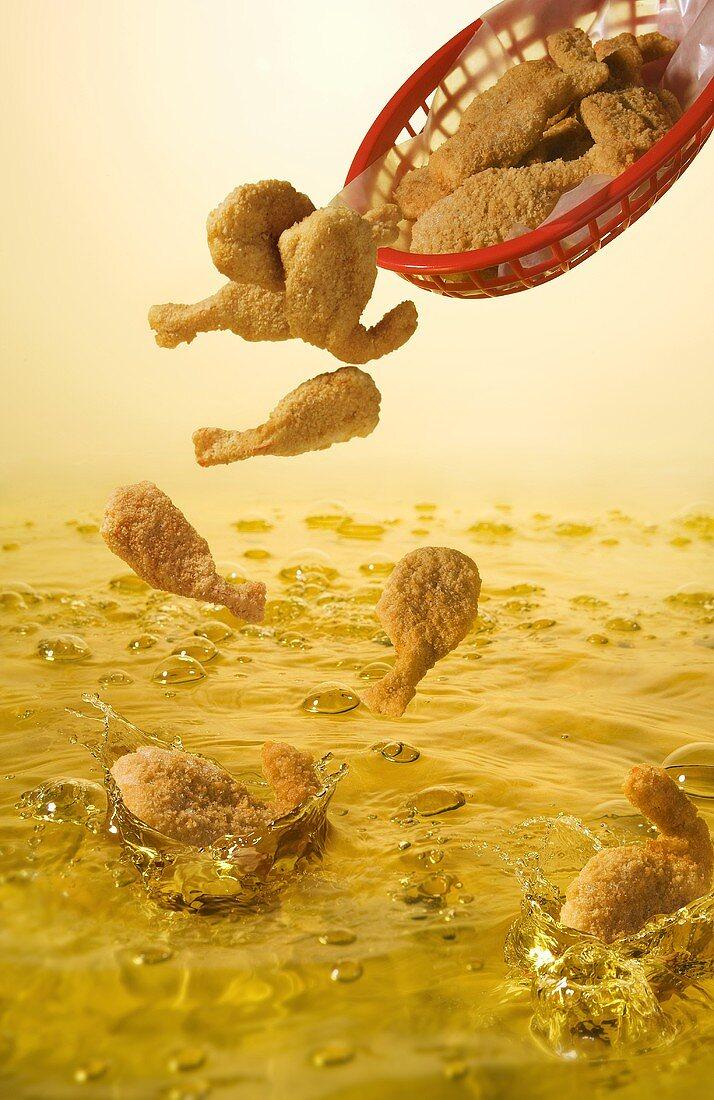 Battered Shrimp Dropping into Oil for Deep Frying