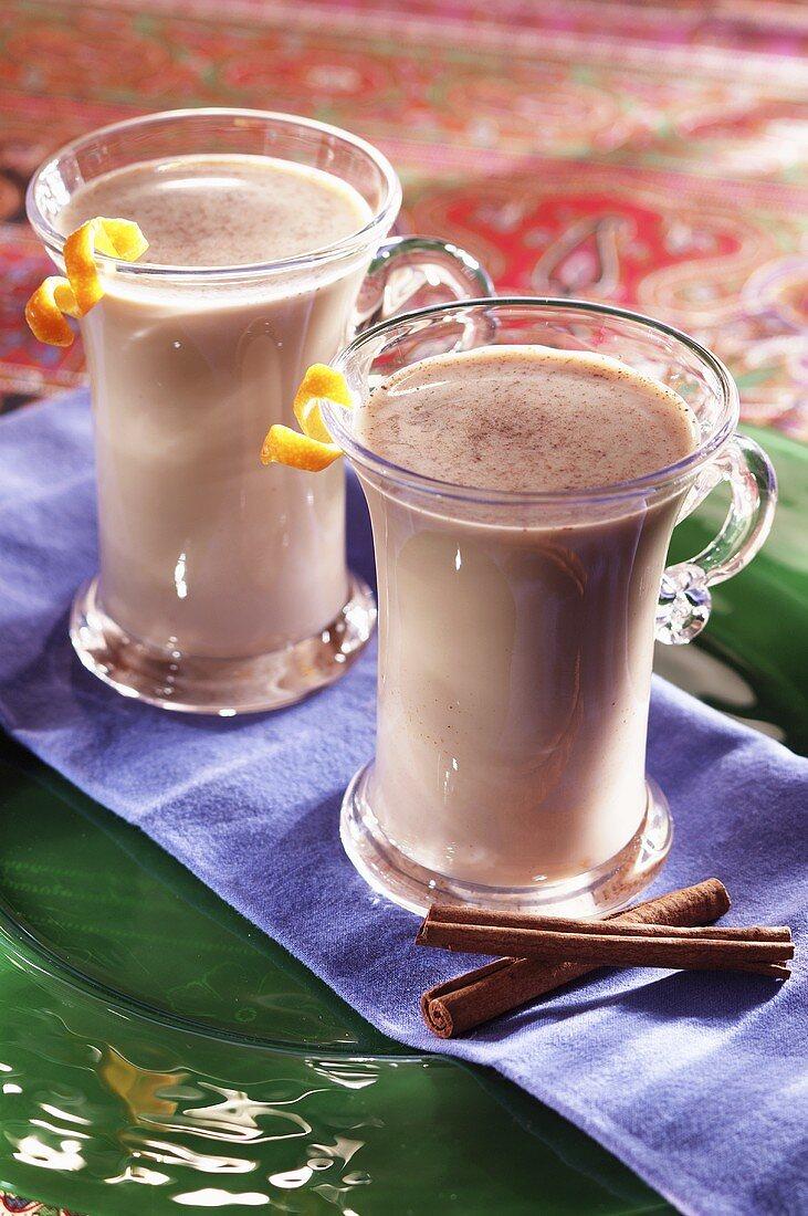 Tea with Milk and Cinnamon in Glass Mugs