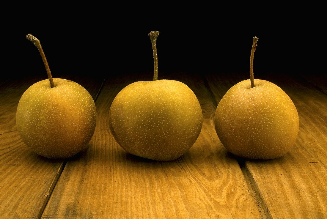 Three Asian Pears on a Wood Table