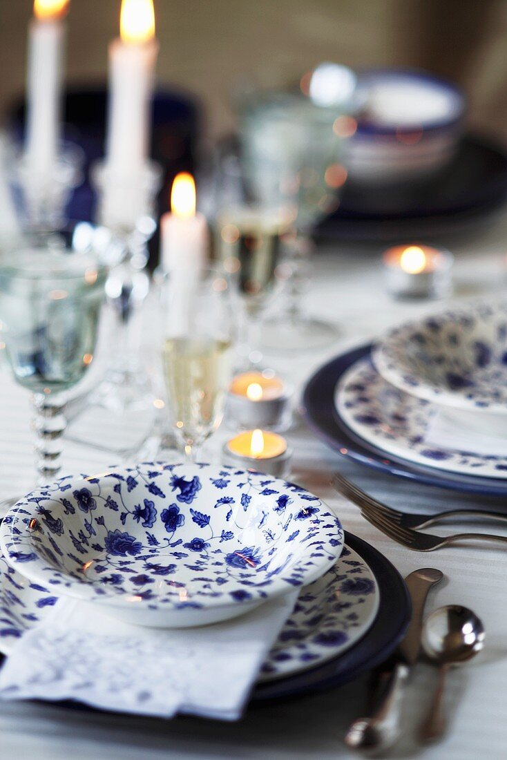 Blue and White Table Setting with Tea Lights and Candles