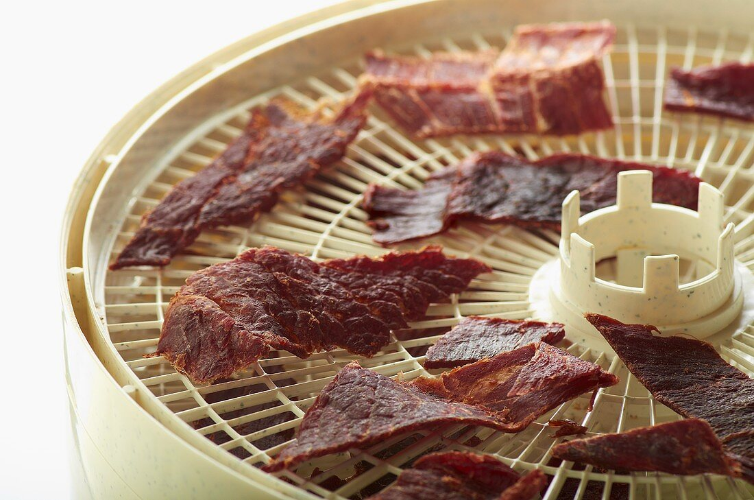 Slices of Teriyaki Spiced Beef Jerky on Dehydrator Trays