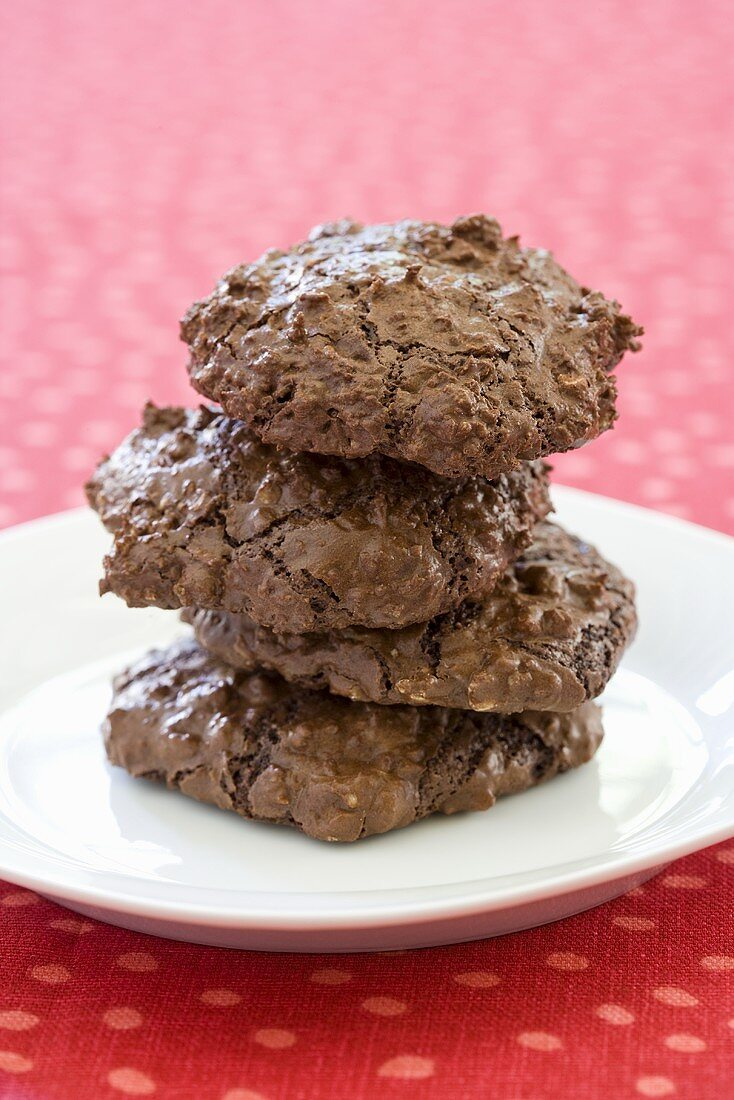 Three Chewy Chocolate Cookies Stack on a Plate
