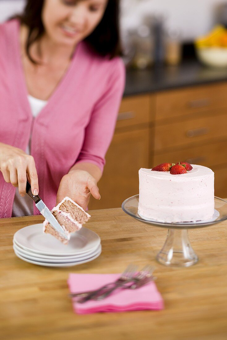 Woman Placing a Slice of Cake on a Plate; In Kitchen