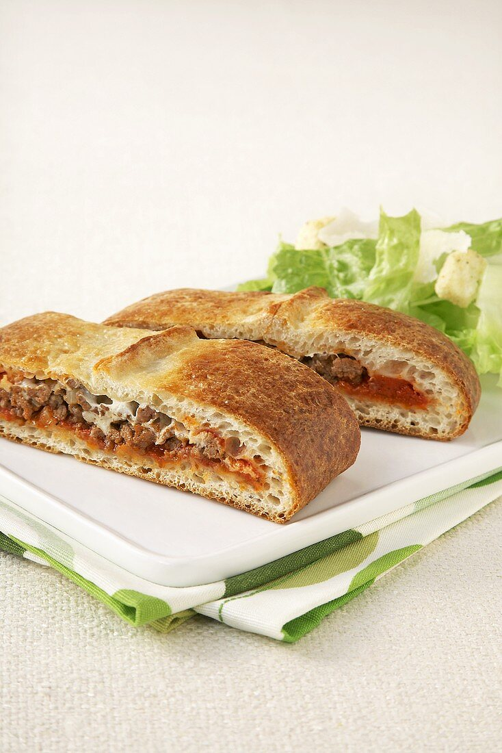 Two Slices of Stromboli with Side Salad