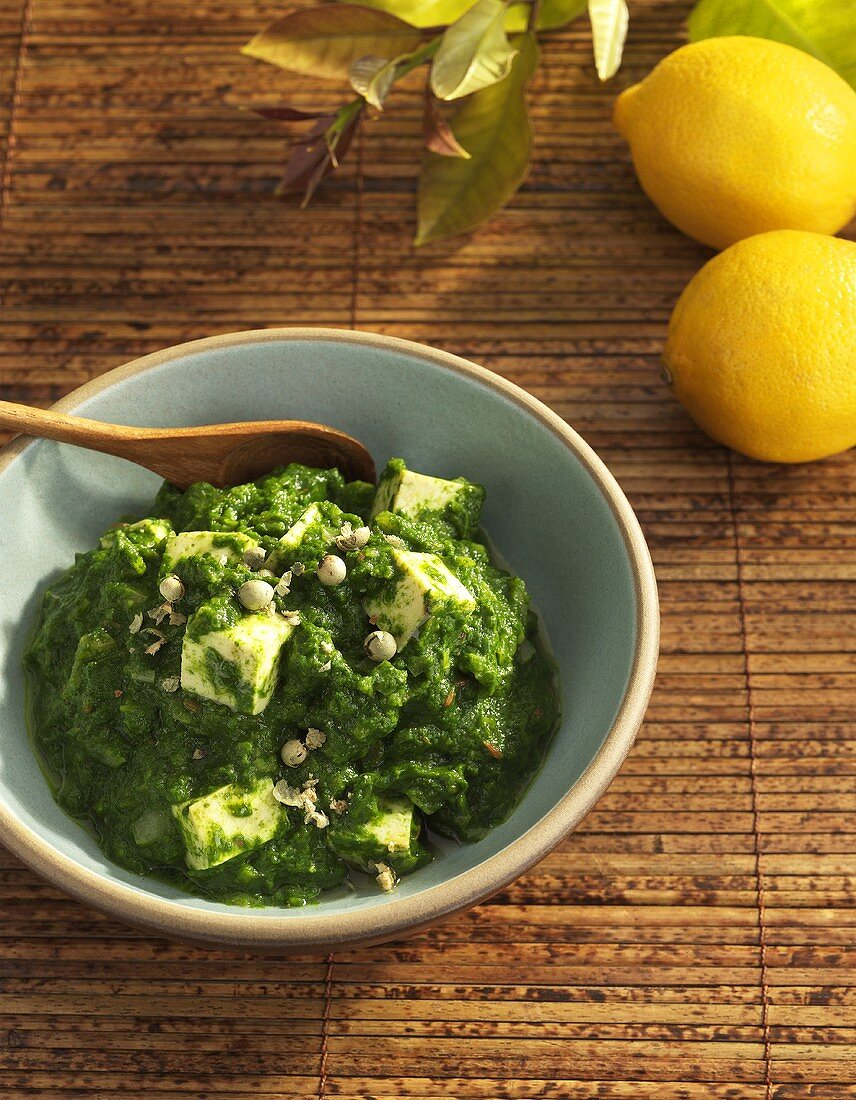 Palak Paneer in a Blue Bowl with Wooden Spoon