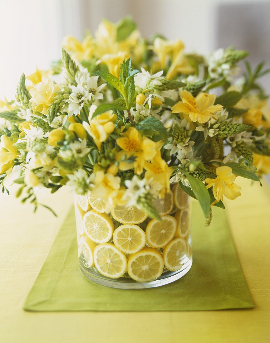 Pretty Yellow and White Flower Arrangement with Lemons in the Vase