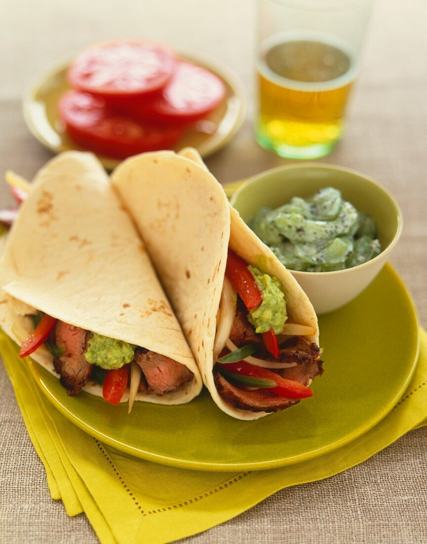 Beef Fajitas with Onions and Peppers and Guacamole