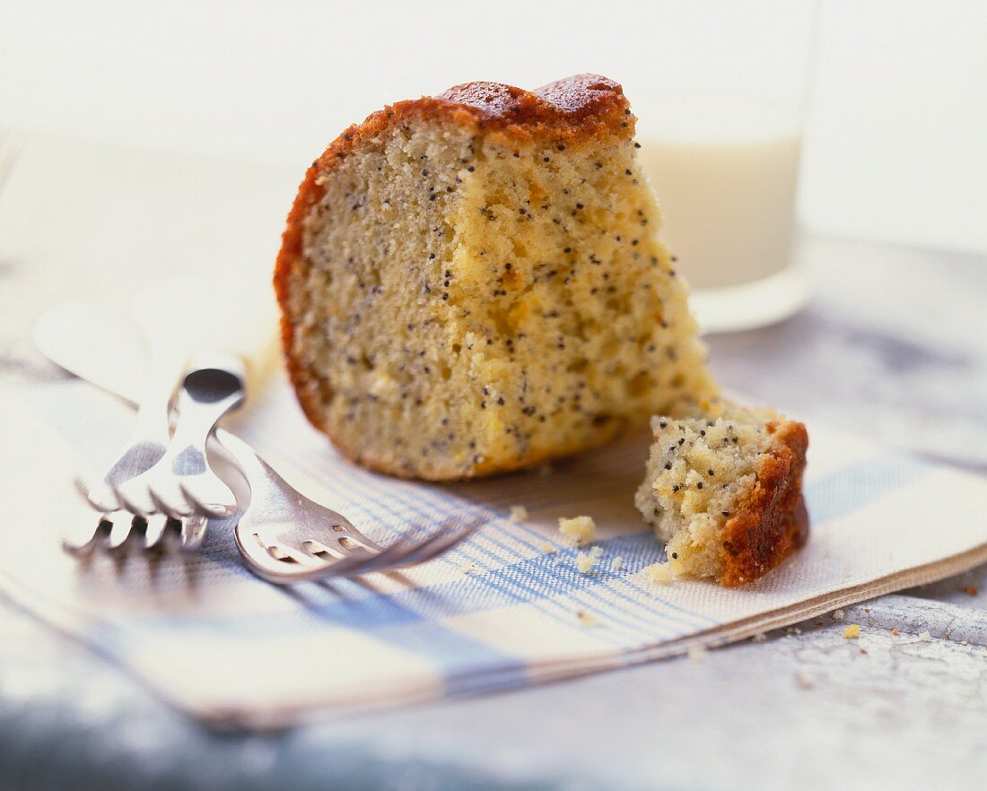 Piece of Lemon Poppy Seed Cake with a Glass of Milk; Forks