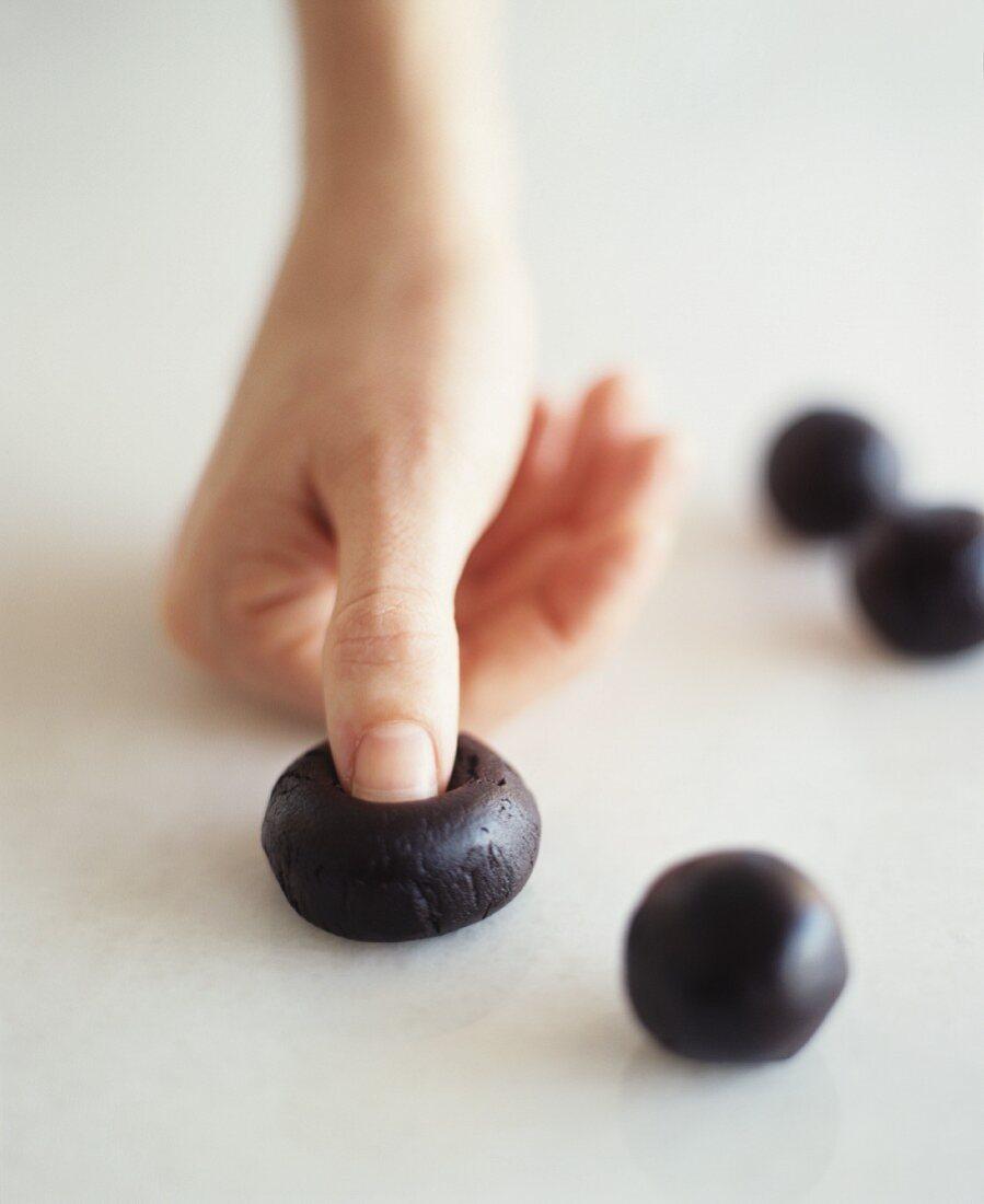 Making Chocolate Thumbprint Cookies