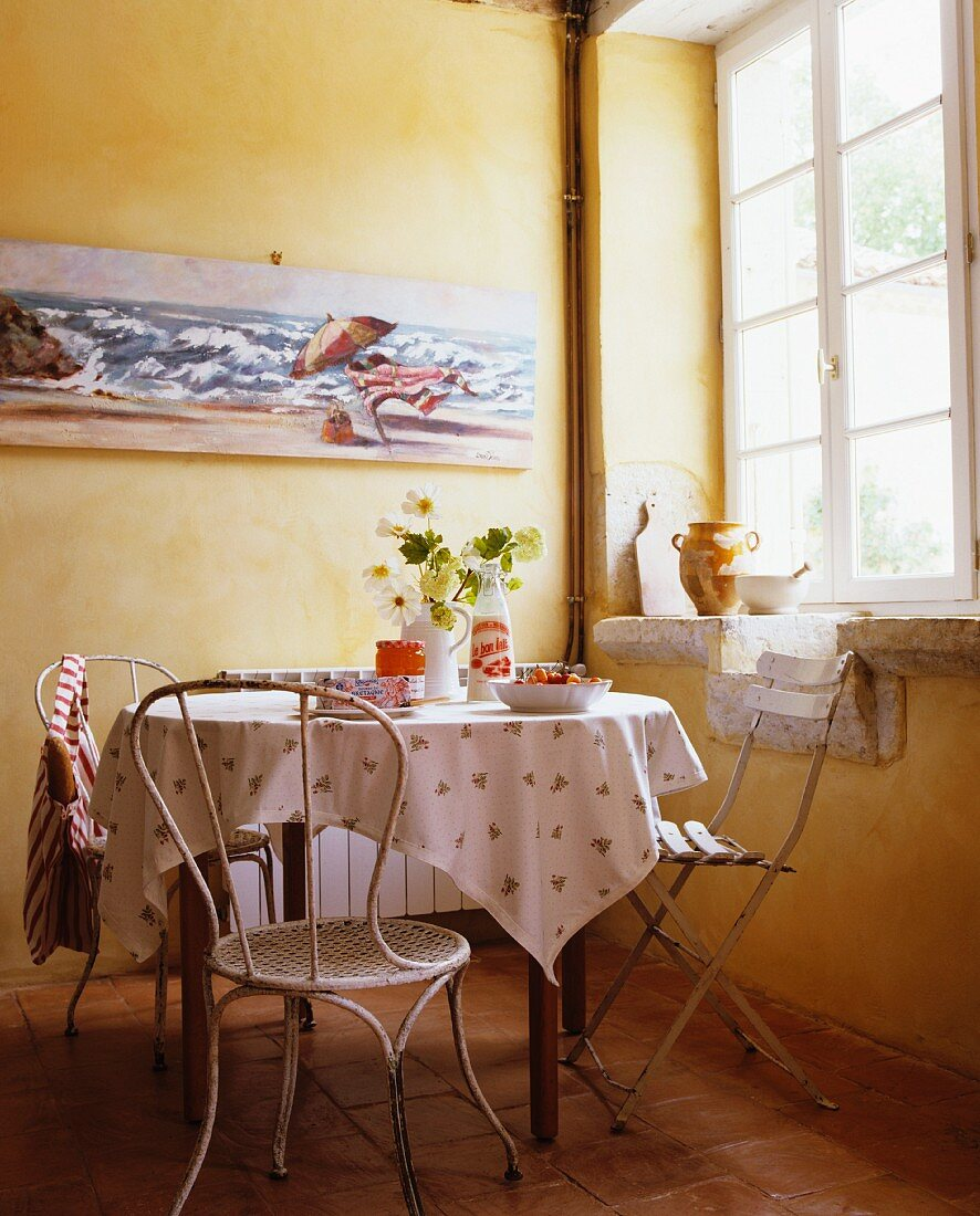 A dining area in front of a window in a country house