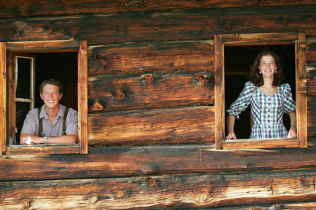 Young couple looking throw window