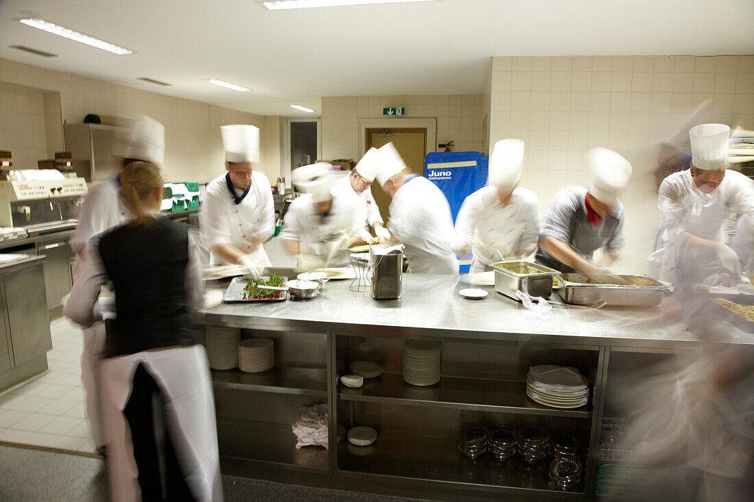 Cooks inside vast kitchen, Hotel Waldhaus, Flims, Canton of Grisons, Switzerland