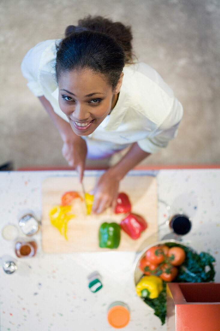 African American woman chopping vegetables, Cape Town, South Africa