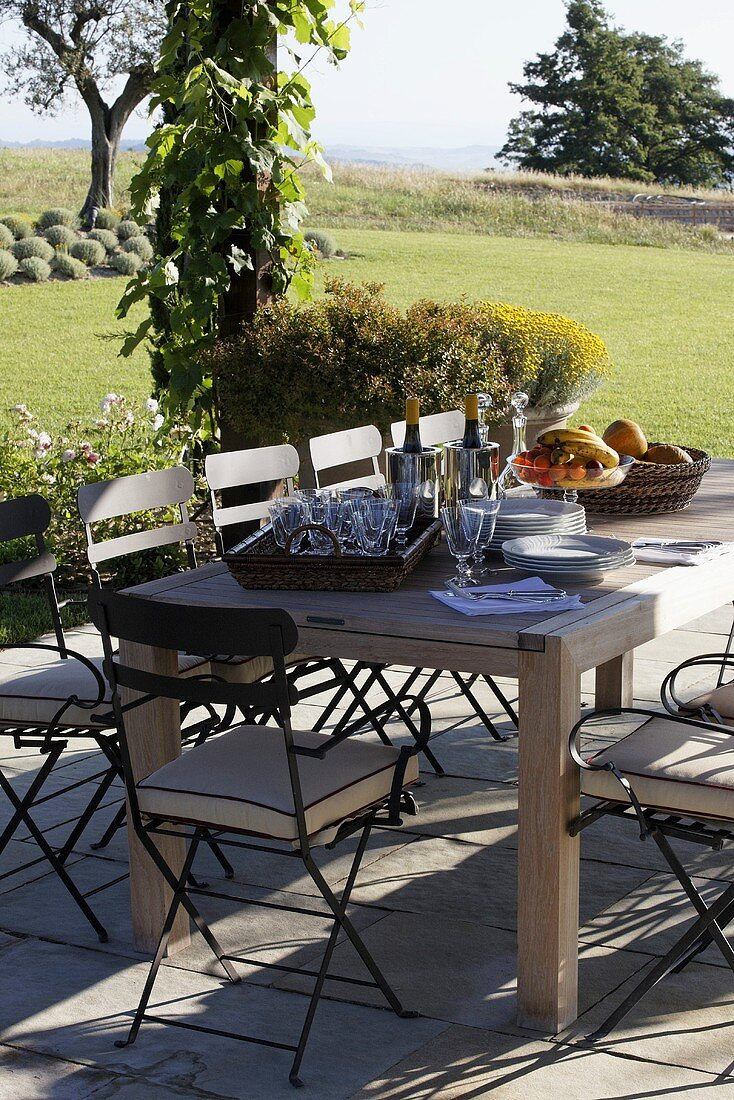 Getting ready to eat -- patio table in a Mediterranean garden