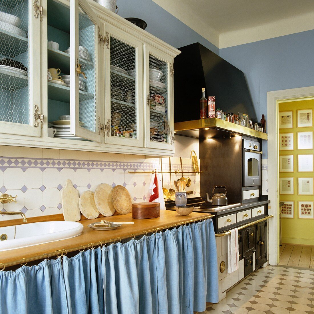 A kitchen in a country house with blue walls