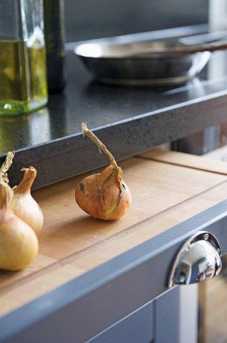 Onions on chopping board