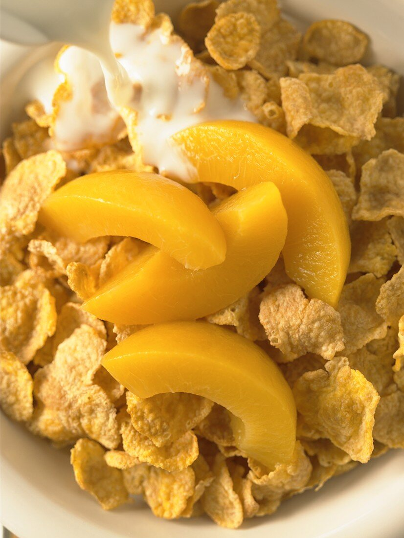 Corn Flake Cereal with Peach Slices and Milk