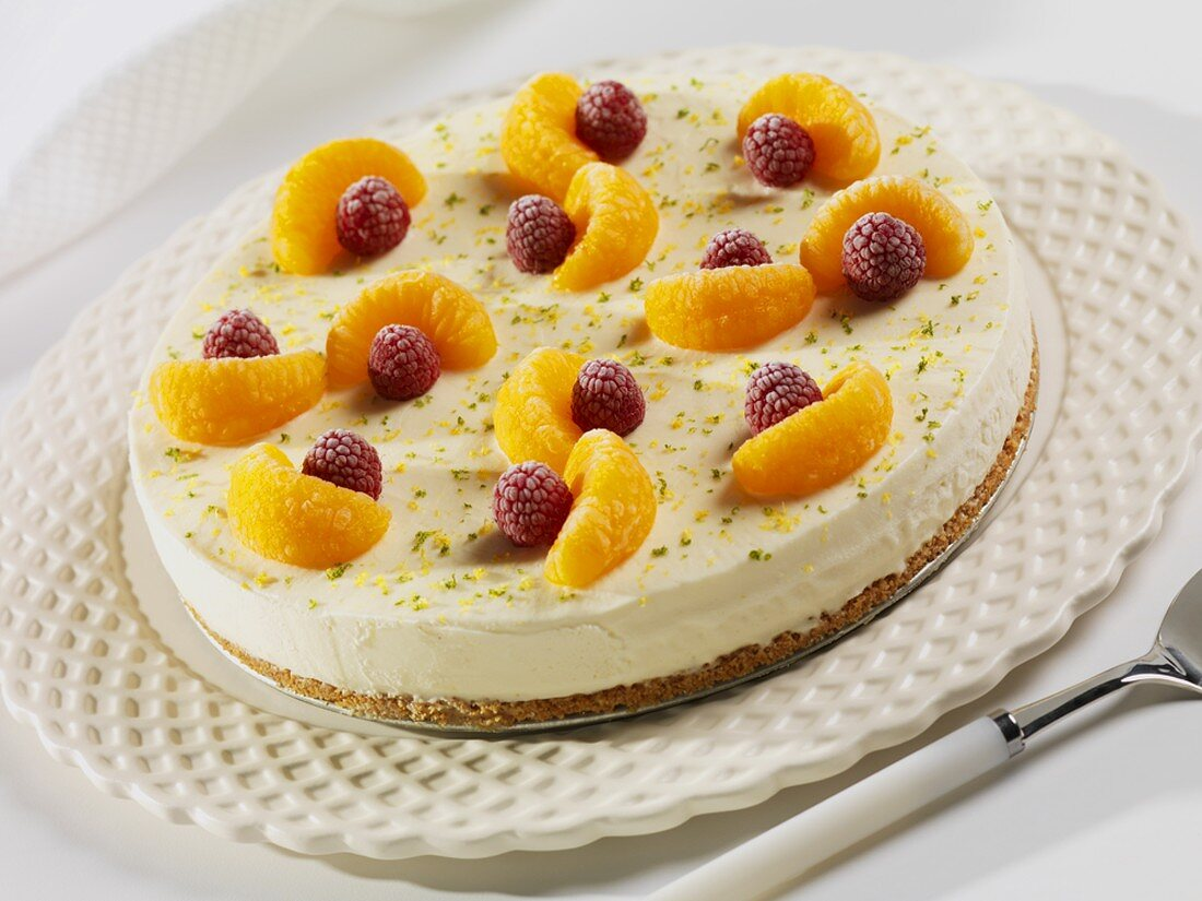 Frozen Key Lime Pie Topped with Mandarin Oranges and Raspberries